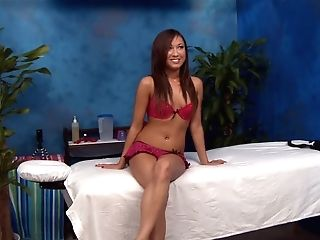 Skinny Dark Haired Masseuse Jesse Clothed In Pink Shows Her