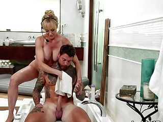 Hot Cougar Massaging Her Customer During A Conference Call